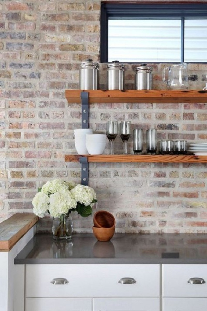 Whitewashed red brick backsplash
